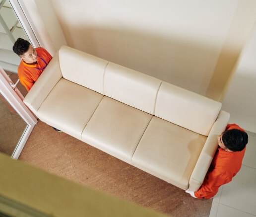 movers-carrying-leather-sofa-